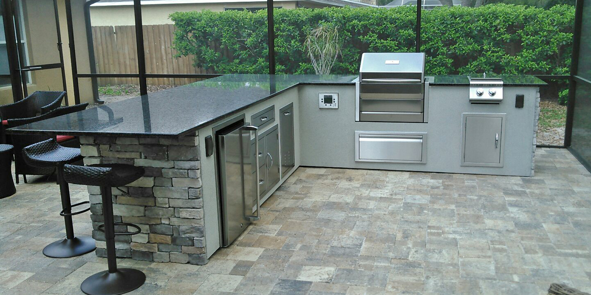 Dryvit-with-Stacked-Stone-Outdoor-Kitchen_Memphis-Wood-Pellet-Grill.jpg